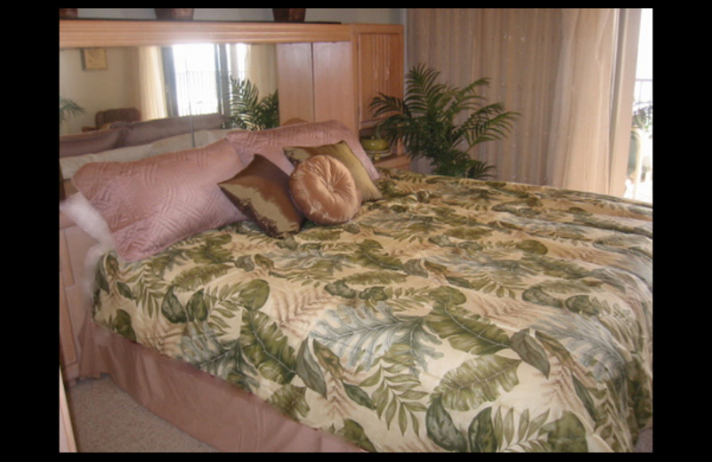Vacation rental bedroom at Florida Beachside Property.