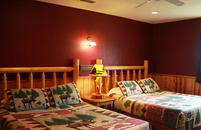 Cabin bedroom at Auger's Pine View Resort.