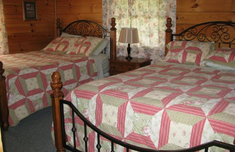 Cabin bedroom at Sunrise Log Cabins.