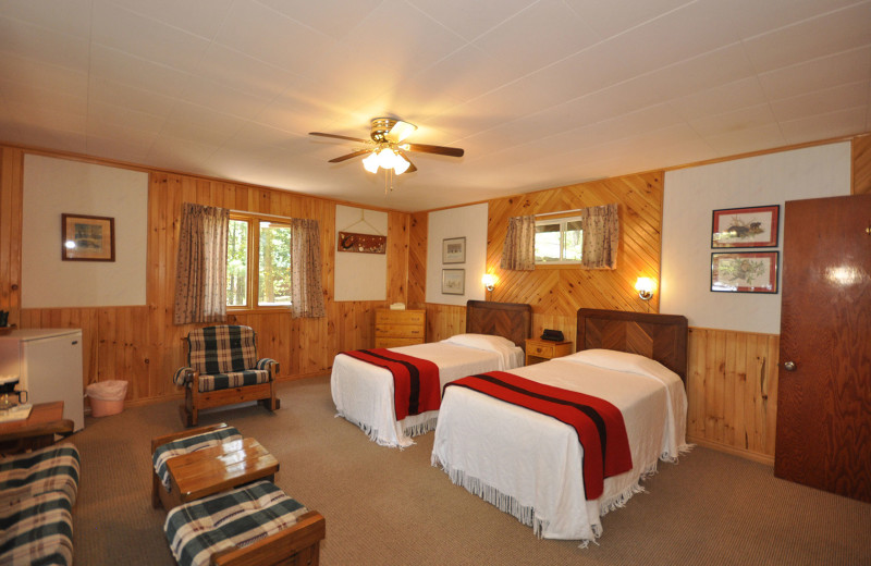 Comfortable guest rooms inside cottage accommodations at Chaudiere Lodge