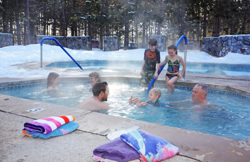 Family in hot tub at Trout Creek Condominium Resort.