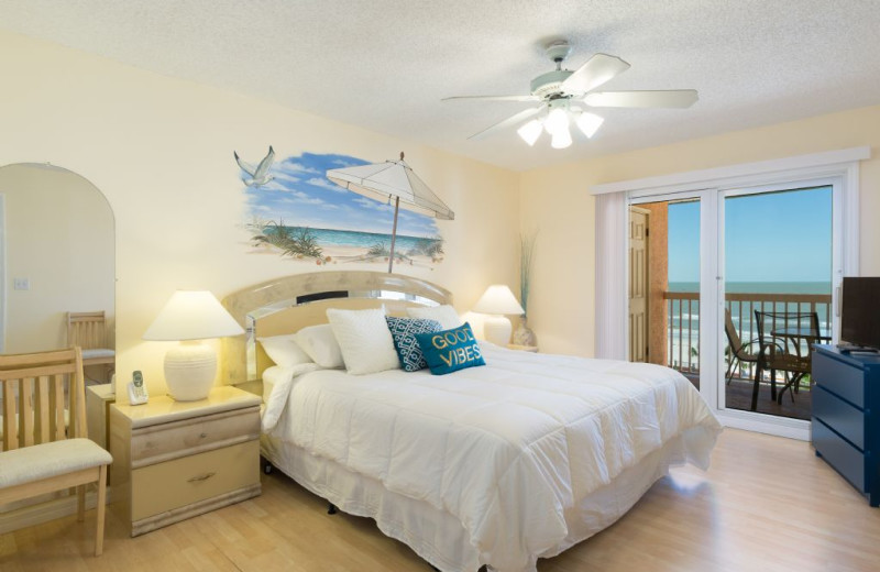 Guest bedroom at Plumlee Gulf Beach Realty.