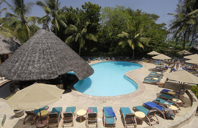 Outdoor pool at Pinewood Village Beach Resort.
