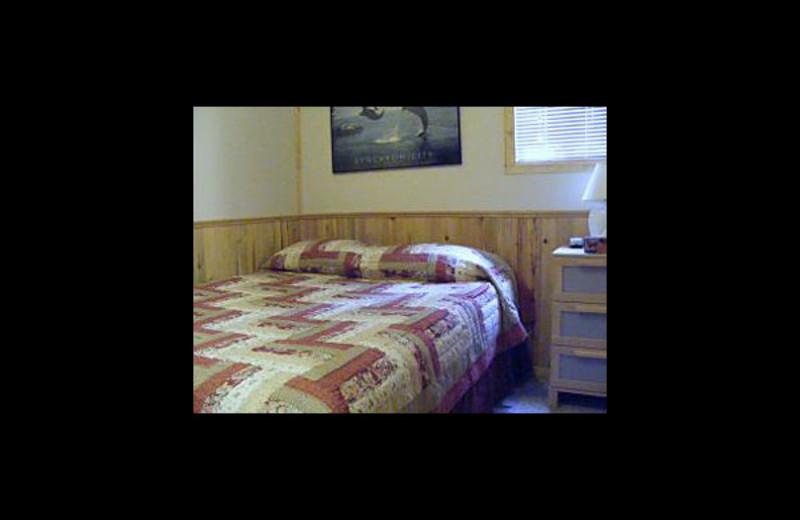 Cabin bedroom at Cheechako Cabins.