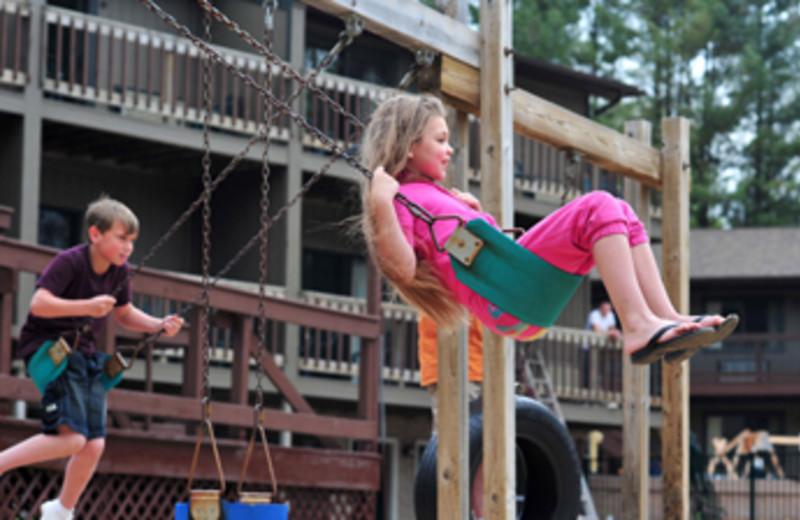 Children swinging at Baker's Sunset Bay Resort.