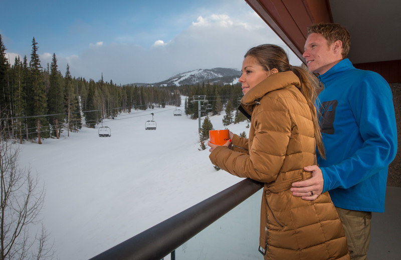 Couple on balcony at Beaver Run Resort & Conference Center.