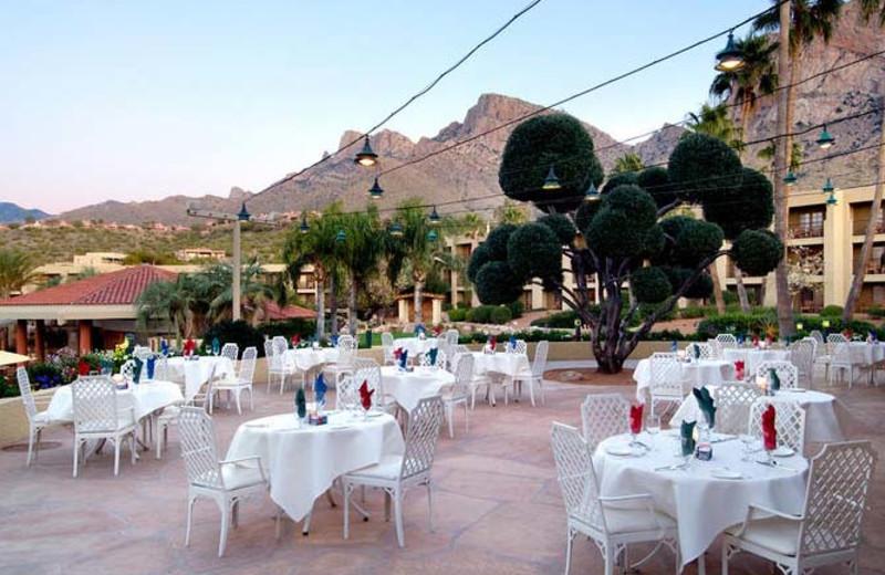 Outdoor dining on the patio at Hilton Tucson El Conquistador Golf & Tennis Resort.