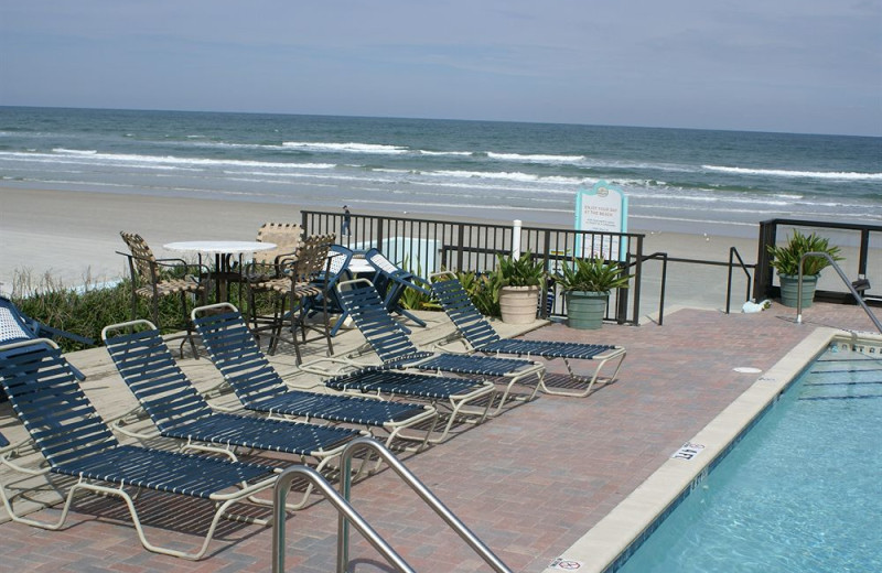 Poolside chairs at Daytona Shores Inn and Suites.