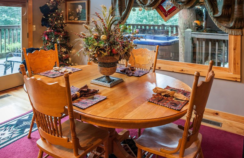 Cabin dining room at Mountain Oasis Cabin Rentals.
