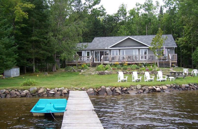 Haliburton Cottage exterior with dock and shoreline.