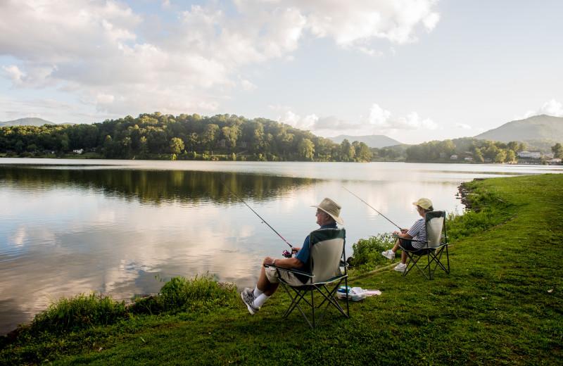 A couple fishes off the banks of beautiful Lake Junaluska.
