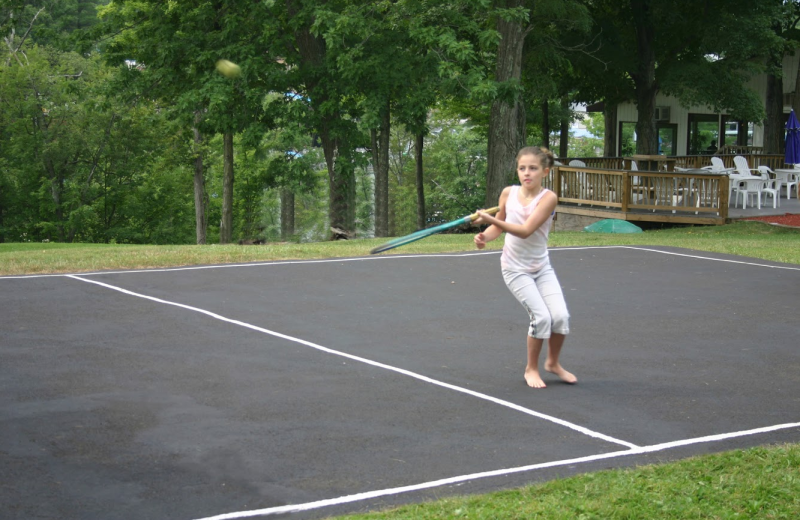 Playing tennis at The Country Place Resort.