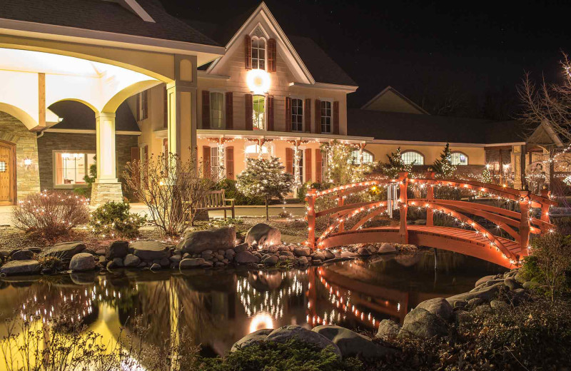 Exterior view of Emerson Resort & Spa lite up at night.