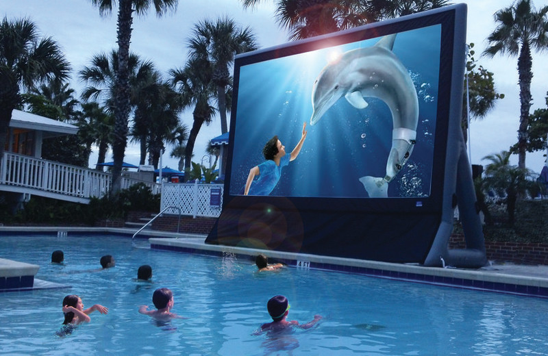 Watching a movie in the pool at TradeWinds Island Grand.