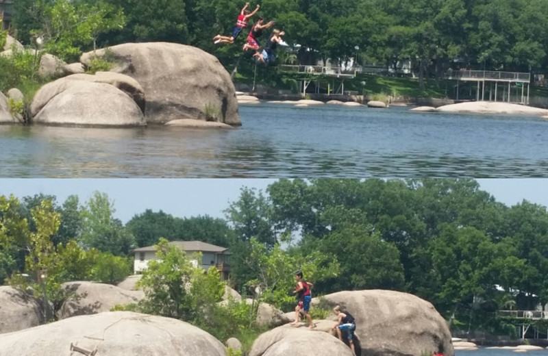 Family jumping into lake at Cool Water Cabin Rental - Lake LBJ.
