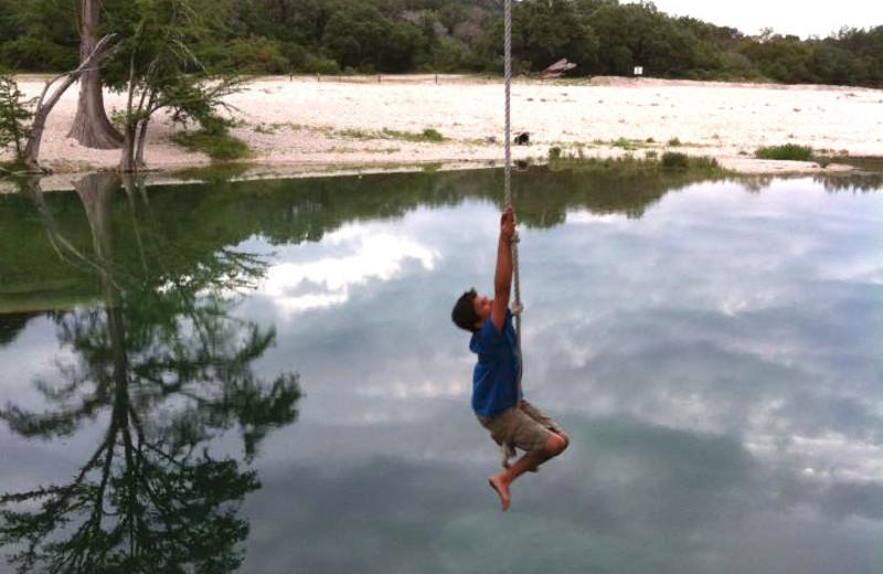 Rope swinging near Neal's Lodges.