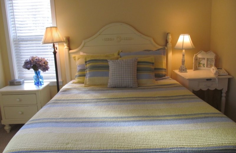 Vacation rental bedroom at Bella Beach Property Management.