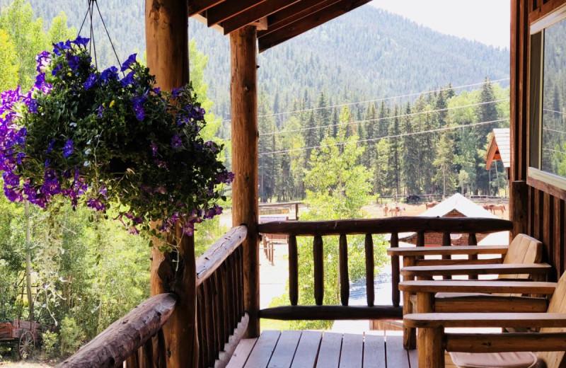 Cabin porch at Tumbling River Ranch.