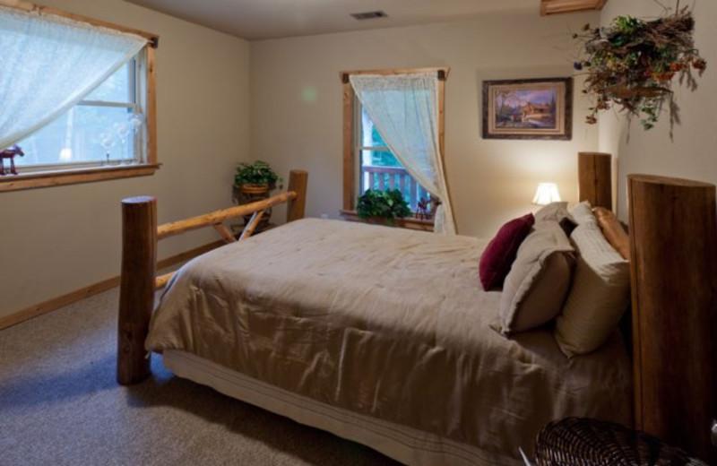 Cabin bedroom at Blue Sky Cabin Rentals.