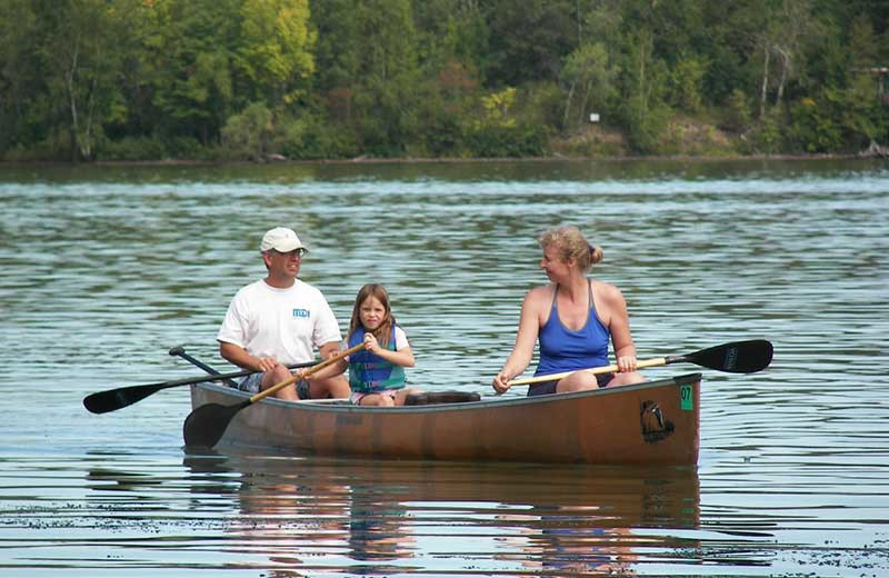 Family in boat at White Manor Resort.