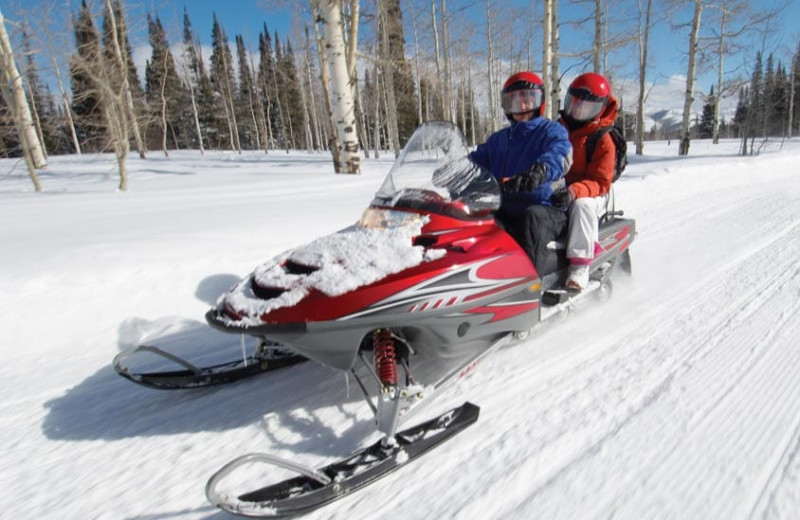 Snowmobiling at Grand Timber Lodge.