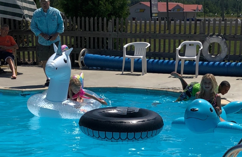 Playing in pool with floats at Pinehurst Motel & Cottages.