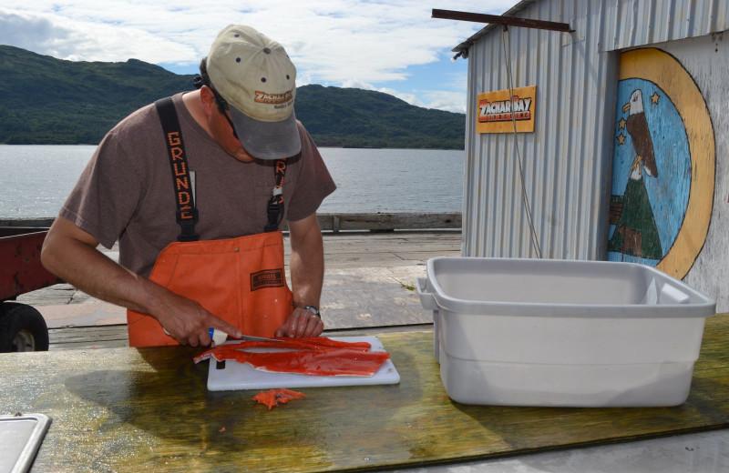 Fish cleaning at Zachar Bay Lodge.