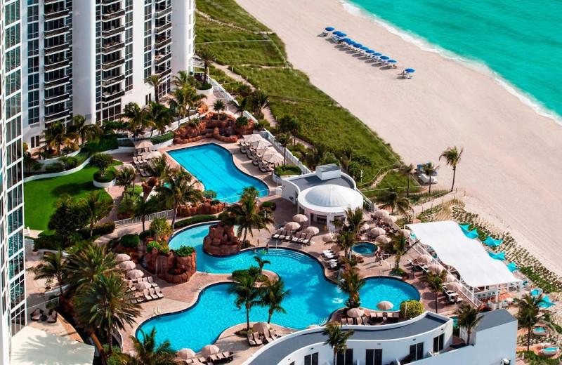 Outdoor pool and beach at Trump International Beach Resort.