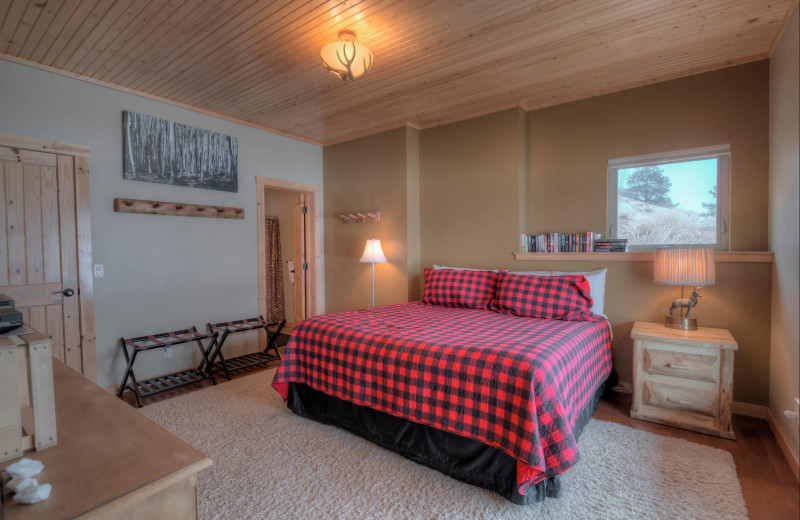 Cabin bedroom at Black Wolf Lodging.