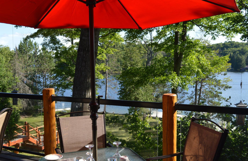 Beautiful view overlooking the lake on the patio while you dine at Heather Lodge.  Be sure to watch for the flying squirrels just after sunset.