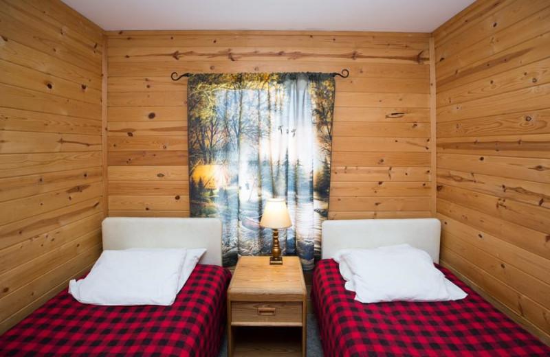 Cabin bedroom at River Bend's Resort & Walleye Inn.