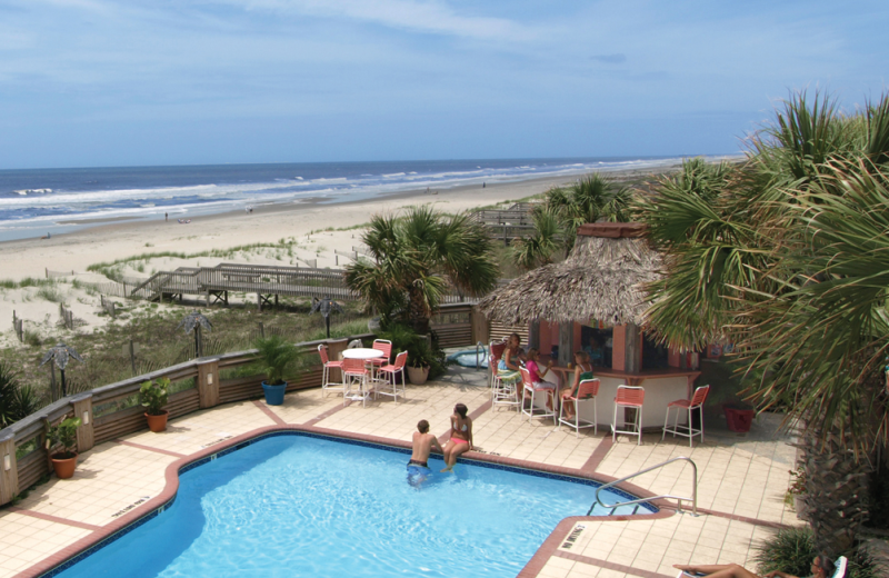 Outdoor pool and beach at The Winds Resort Beach Club.