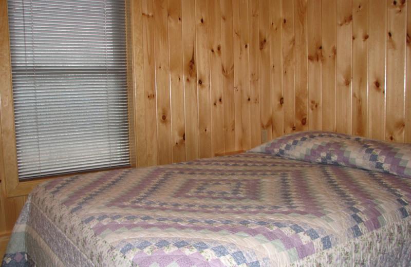 Cottage bedroom at Angel Rock Waterfront Cottages.
