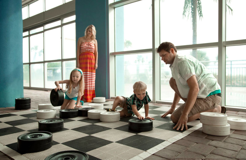 Family playing checkers at Bay View Resort.