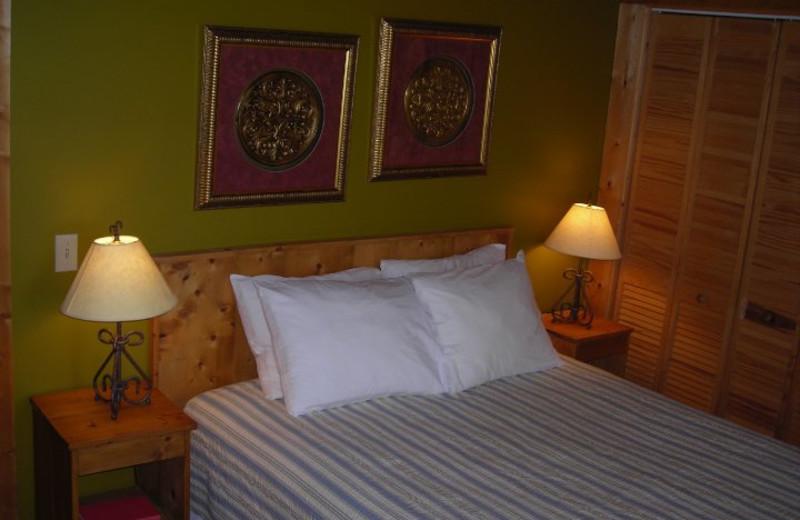 Cabin bedroom at Rock Creek Cabins.