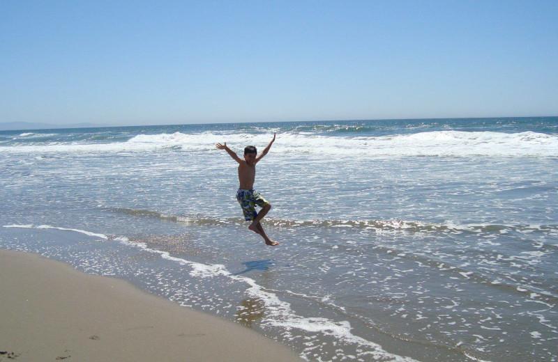 Kid on beach at Pajaro Dunes Resort.