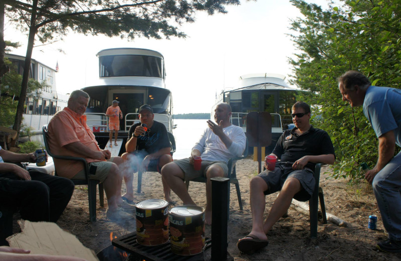 Cooking beans by the fire at Ebel's Voyageur Houseboats.