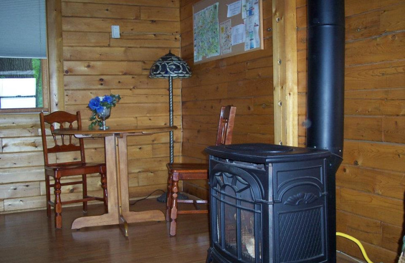 Cabin fireplace and dining table at Sunset Ridge Log Cabins.