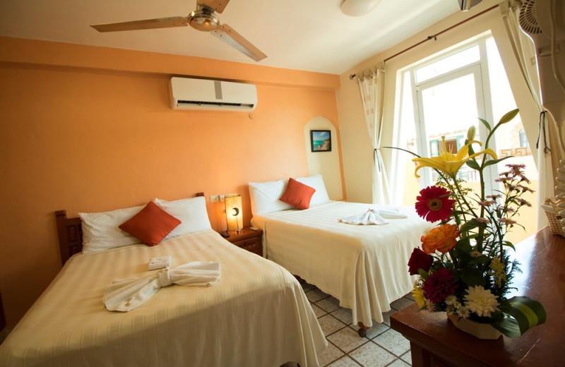 Guest room at El Meson Hotel.