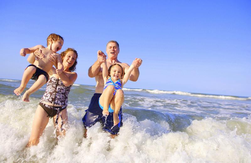 Family on the beach at Islander Hotel & Resort.