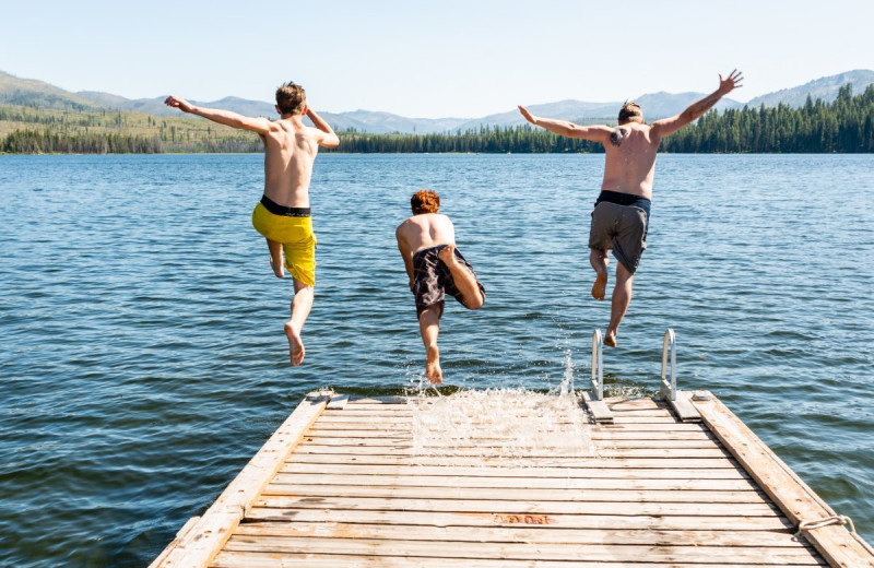 Kids jumping off dock at North Shore Lodge & Resort.