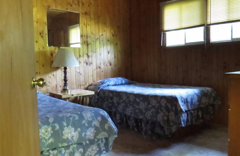 Cabin bedroom at Evergreen Resort.