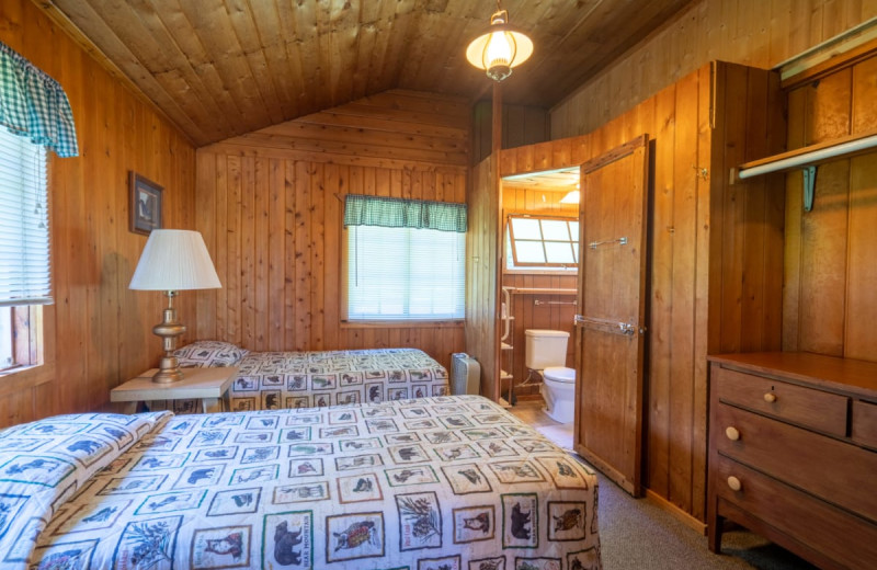 Cabin bedroom at Rising Eagle Resort.