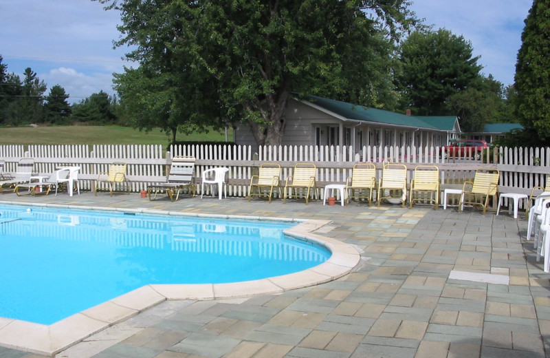 Outdoor pool at Pinehurst Motel & Cottages.