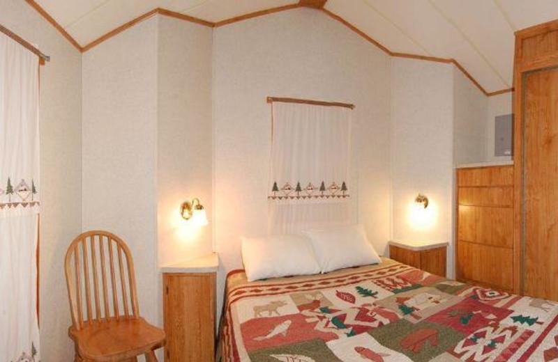Cabin bedroom at Yogi Bear's Jellystone Park Warrens.