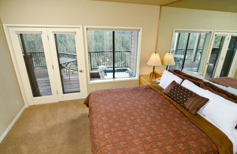 View from the Bedroom of a River Ridge Condo, Hot Tub on the Deck with Views of the River at Mount Bachelor Village Resort.