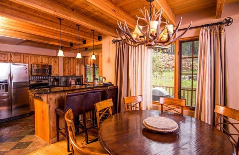 Rental kitchen and dining at Black Diamond Vacation Rentals.