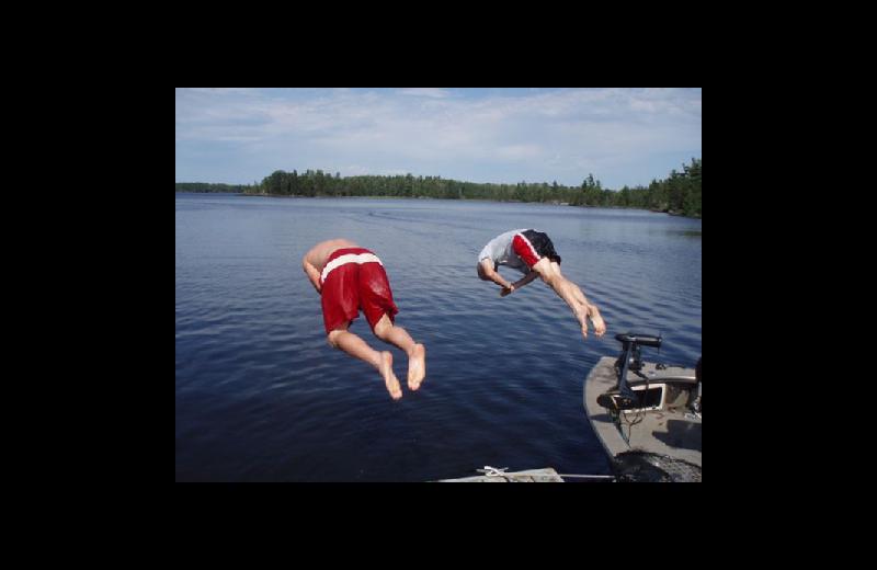 Jumping in lake at Stokes Bay Resort.