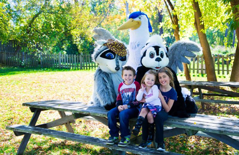 Family and mascots at Vine Ridge Resort.