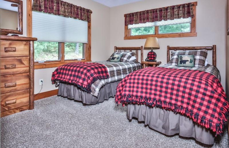 Cabin bedroom at Serenity Bay Resort.